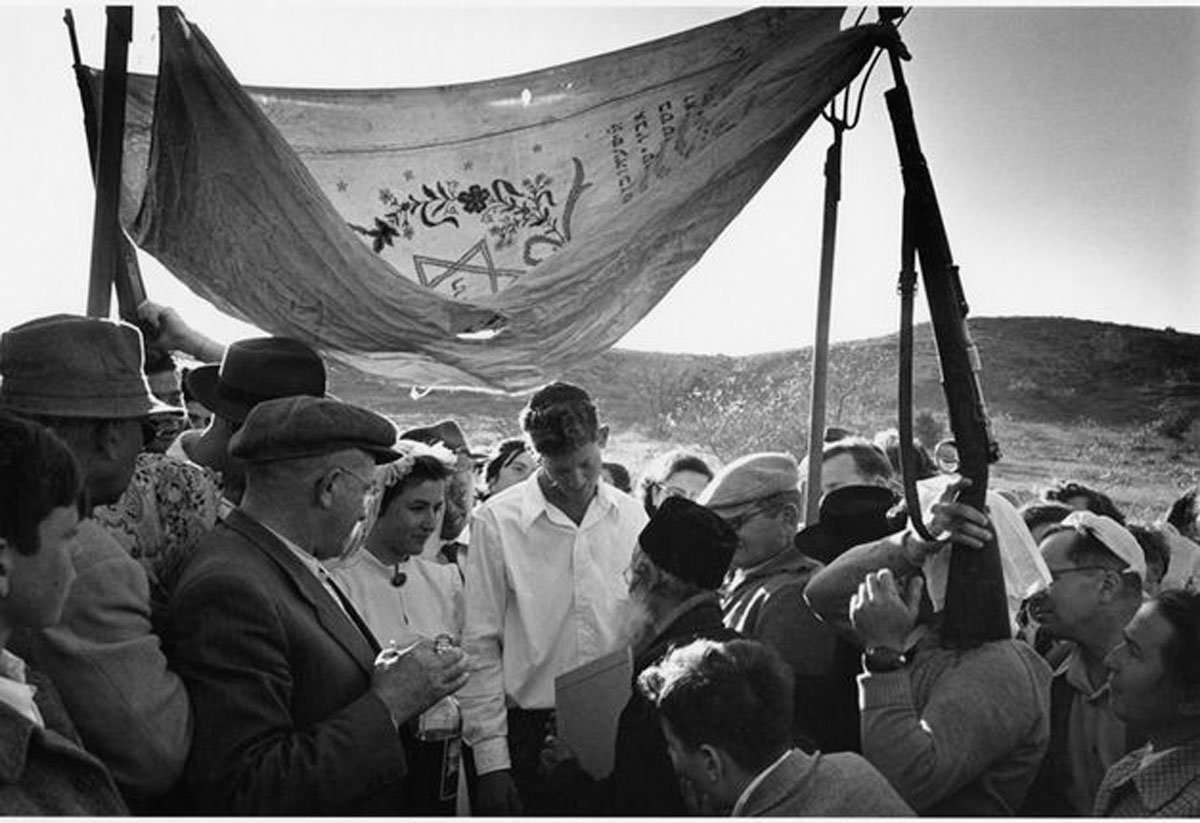 Wedding with a Chuppah Held Up by Rifles and Pitchforks (1952), photograph by David Seymour © Chim (David Seymour)/ Magnum Photos