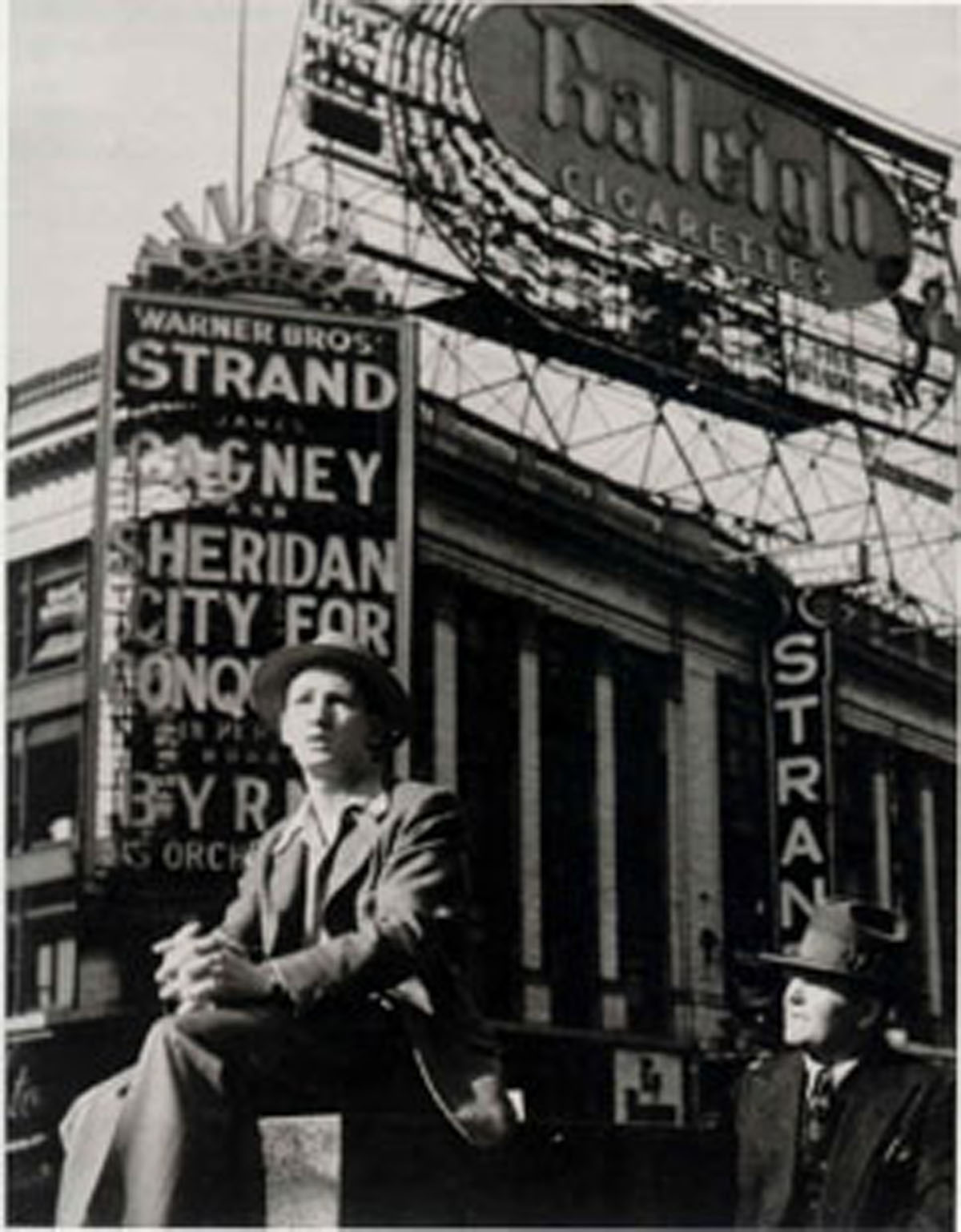 Sitting in Front of the Strand, Times Square (1940) photograph by Lou Stouman Courtesy Barry Singer Gallery, Petaluma, California